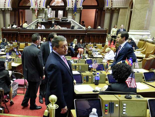 Assembly Majority Leader Joseph Morelle, left, speaks to Assembly members on the floor during a lull in the proceedings Thursday afternoon, June 25, 2015, at the Capitol in Albany, N.Y. (Skip Dickstein/Times Union) Photo: SKIP DICKSTEIN / 00032391A
