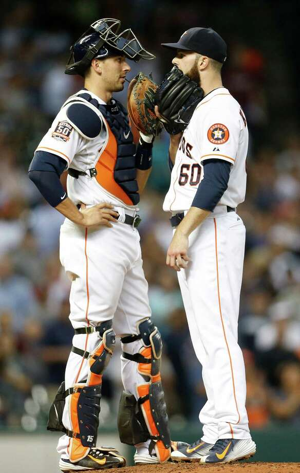 Astros starter Dallas Keuchel confers with catcher Jason Castro in the ninth inning. Castro helped guide Keuchel through his 116-pitch effort against the Yankees. Photo: Karen Warren, Staff / © 2015 Houston Chronicle