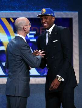 NEW YORK, NY - JUNE 25:  Kevon Looney meets Commissioner Adam Silver after being selected 30th overall by the Golden State Warriors in the First Round of the 2015 NBA Draft at the Barclays Center on June 25, 2015 in the Brooklyn borough of  New York City. NOTE TO USER: User expressly acknowledges and agrees that, by downloading and or using this photograph, User is consenting to the terms and conditions of the Getty Images License Agreement.  (Photo by Elsa/Getty Images)