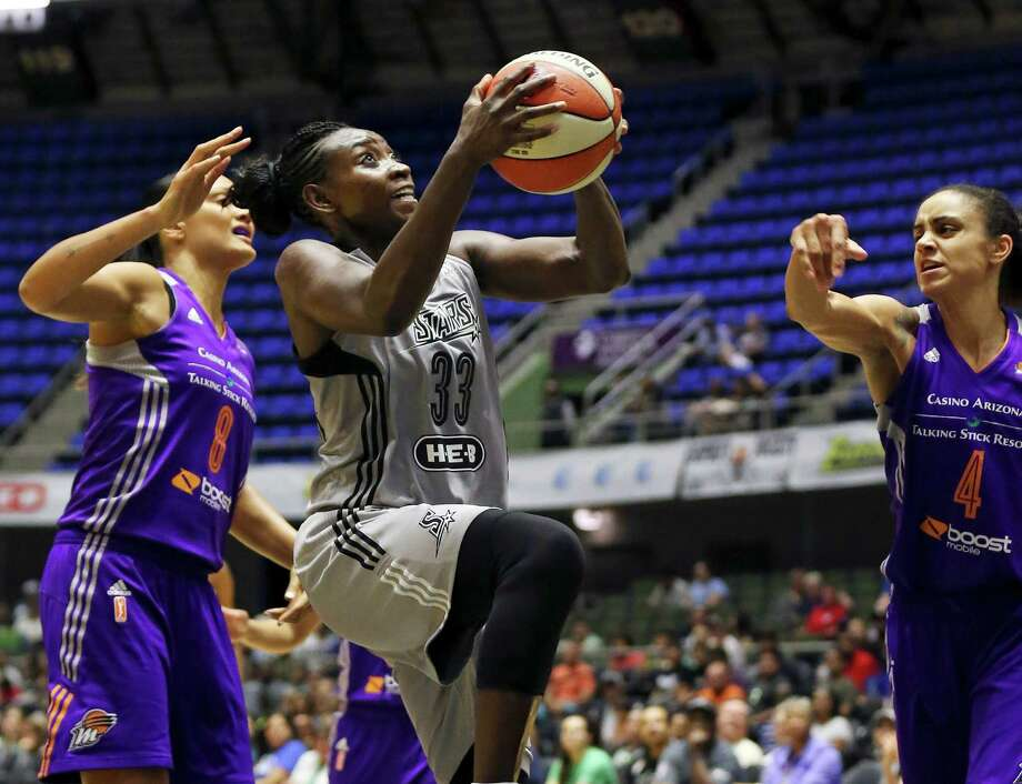 San Antonio Stars' Sophia Young-Malcolm drives to the basket between Phoenix Mercury's Mistie Bass (left) and Candice Dupree during first half action Thursday June 25, 2015 at the Freeman Coliseum. Photo: Edward A. Ornelas, Staff / San Antonio Express-News / © 2015 San Antonio Express-News