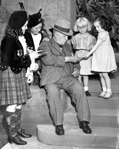 Golden Gate Park superintendent John McLaren celebrates his birthday with his granddaughter and other children on May 24, 1941. Photo: Chronicle Staff / The Chronicle 1941 / ONLINE_YES