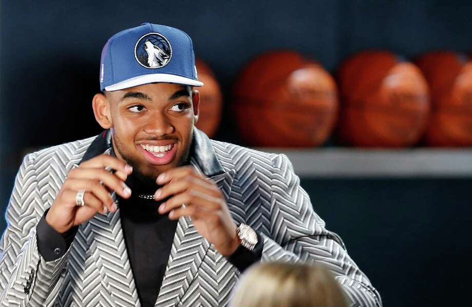 Karl-Anthony Towns reacts after being selected first overall by the Minnesota Timberwolves during the NBA basketball draft, Thursday, June 25, 2015, in New York. (AP Photo/Kathy Willens) Photo: Kathy Willens, STF / AP