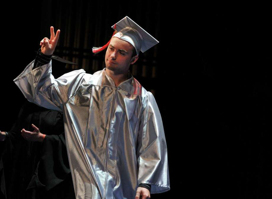 Graduate Michael Capoccia gives a peace sign to the crowd as he walks across the stage during the Niskayuna High School graduation ceremony Thursday, June 25, 2015, at Proctors Theater in Schenectady, N.Y. (Phoebe Sheehan/Special to The Times Union) Photo: PS / 00032175A