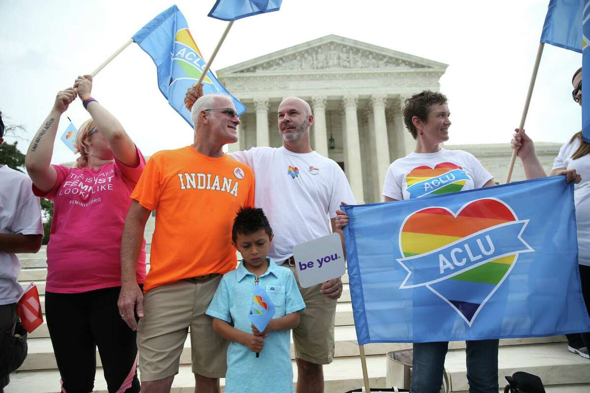 Demonstrators in support of same-sex marriage gather outside the U.S. Supreme Court in Washington, June 26, 2015. The Supreme Court will rule soon on Obergefell v. Hodges and three related cases, which will decide whether the Constitution guarantees a right to same-sex marriage.