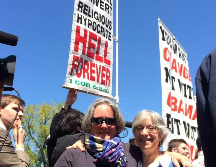 The girlfriend (on the left) and me, in front of the Supreme Court protesters. Photo: Gray, Lisa, Courtesy Leah Lax
