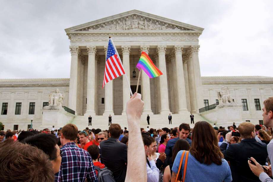 The crowd celebrates outside of the Supreme Court in Washington, Friday June 26, 2015, after the court declared that same-sex couples have a right to marry anywhere in the US. Photo: Jacquelyn Martin, Associated Press / AP