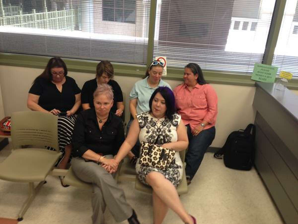 Gay Couples wait for marriage licenses at Bexar County Clerks.