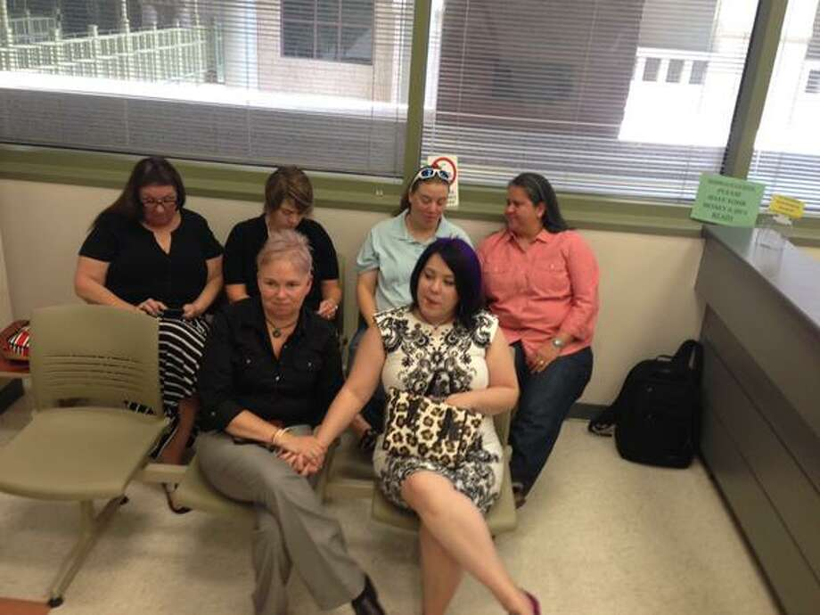 Same-sex couples wait for marriage licenses at Bexar County Clerks on June 26, 2015. Photo: Jerry Lara/San Antonio Express-News