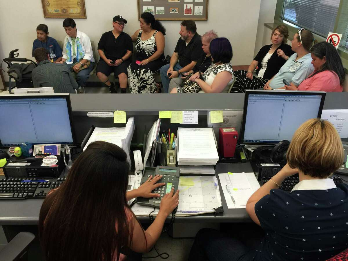 Couples line up for marriage licenses at the Bexar County Courthouse the morning of Friday, June 26, 2015.