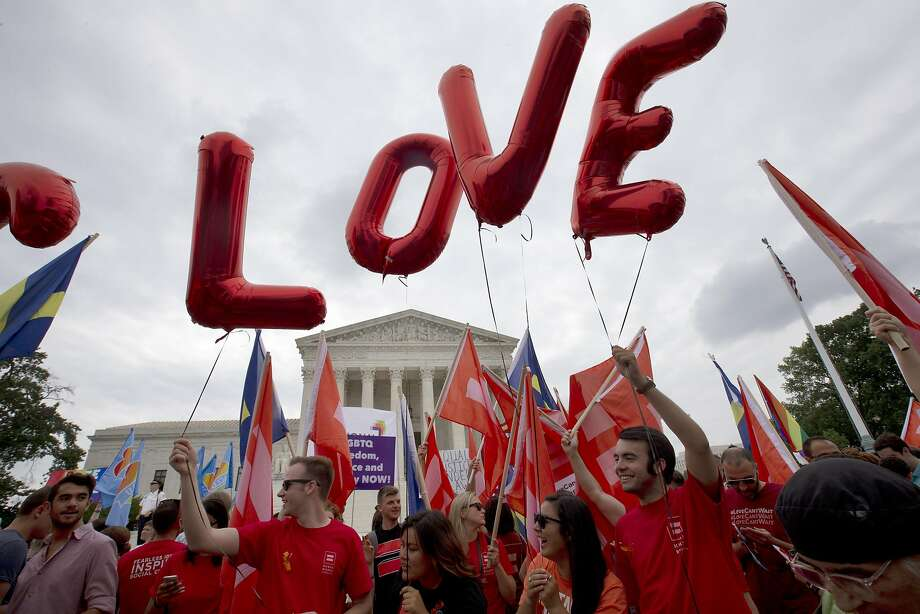 "Balloons spell out the word ""love"" over the Supreme Court in Washington, Friday June 26, 2015, after the court declared that same-sex couples have a right to marry anywhere in the US.  Photo: Jacquelyn Martin, Associated Press"
