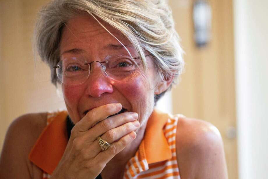Ann Pinchak reacts after hearing the U.S. Supreme Court decision to  legalize same-sex marriage