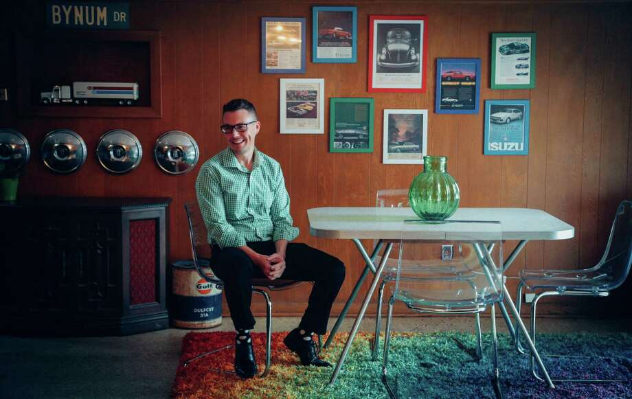 """Ross Bynum enjoys the 1950s-era house he recently purchased in Glenbrook Valley. """"It was really cool,"""" the 29-year-old says.  Photo: Billy Smith II, Staff / © 2015 Houston Chronicle"""