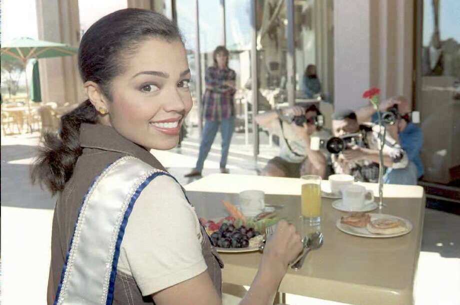 MAY 14: Miss Universe 95, Chelsi Smith of the US is photographed during breakfast 14 May at a Windhoek Country Club, Namibia. Smith was crowned early 13 May in the Namibian capital. Second was Manpreet Brar from India and Lana Buchberger from Canada, third. AFP PHOTO (Photo credit should read PHILIP LITTLETON/AFP/Getty Images) Photo: PHILIP LITTLETON, AFP, Getty Images