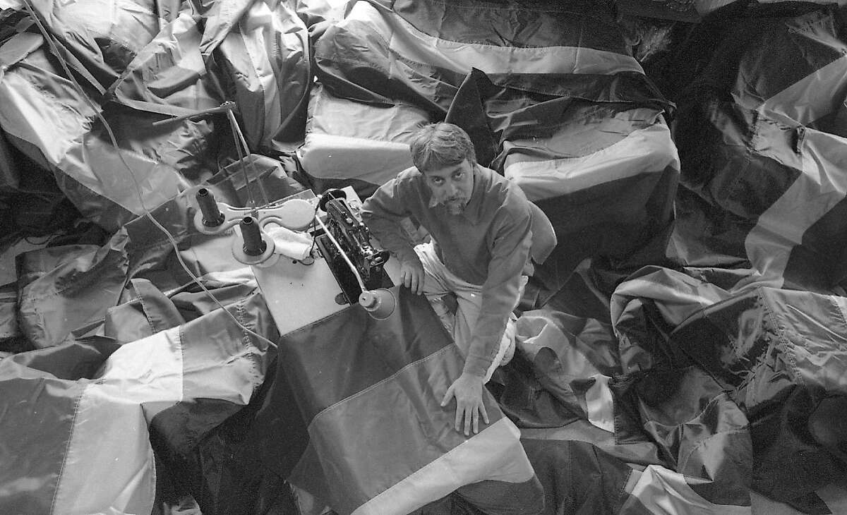 Gilbert Baker, the artist who designed the Rainbow Flag, making 500 new flags for an installation on Market St. on June 10th 1998.