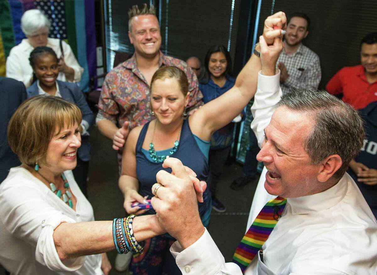 Allie Levey, left, Nikki Araguz, center, and Mitchell Katine celebrate the U.S. Supreme Court decision legalizing same-sex marriage at Katine's law office on Friday, June 26, 2015.