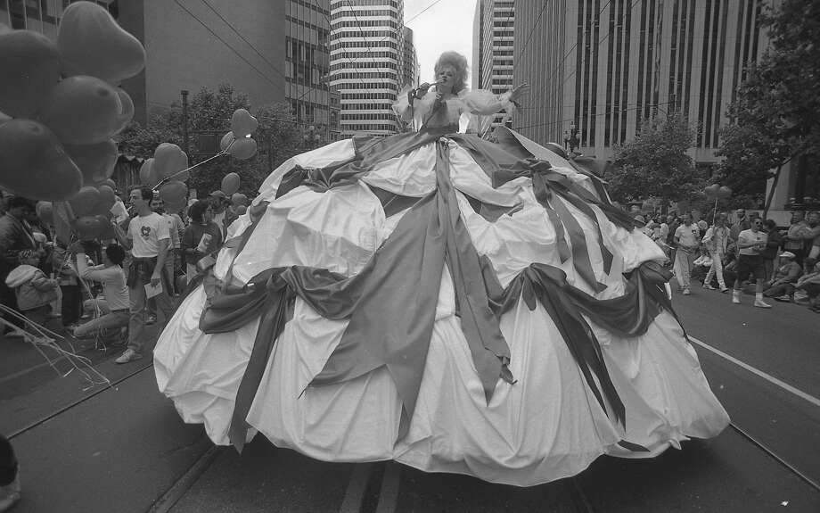 "Sherry McKnight, a four-time Cable Car award winner sings ""Stand by your Man"" while wearing a huge dress as she rolls down Market Street with other paraders at the Gay Freedom Day parade.  Photo: Tom Levy, The Chronicle"