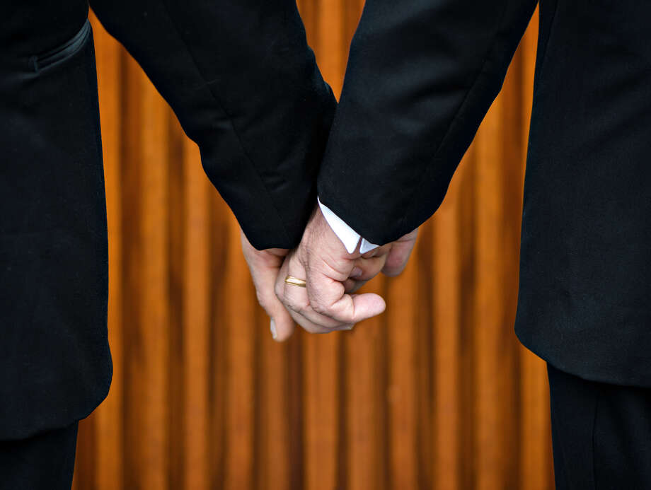 Same-sex marriage. Gay marriage. Two men getting married. Photo: Fotolia / Shsphotography / SHS Photography