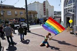 "Maria Lucent dances to a cover of U2's song ""Pride in the Name of Love"" on Harvey Milk Plaza in celebration in the Castro neighborhood of San Francisco, California, on Friday, June 26, 2015."
