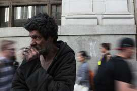 Calap Jayjenkins, 54, watches as San Franciscans in the Financial District pass by.  He has been homeless for over 30 years.