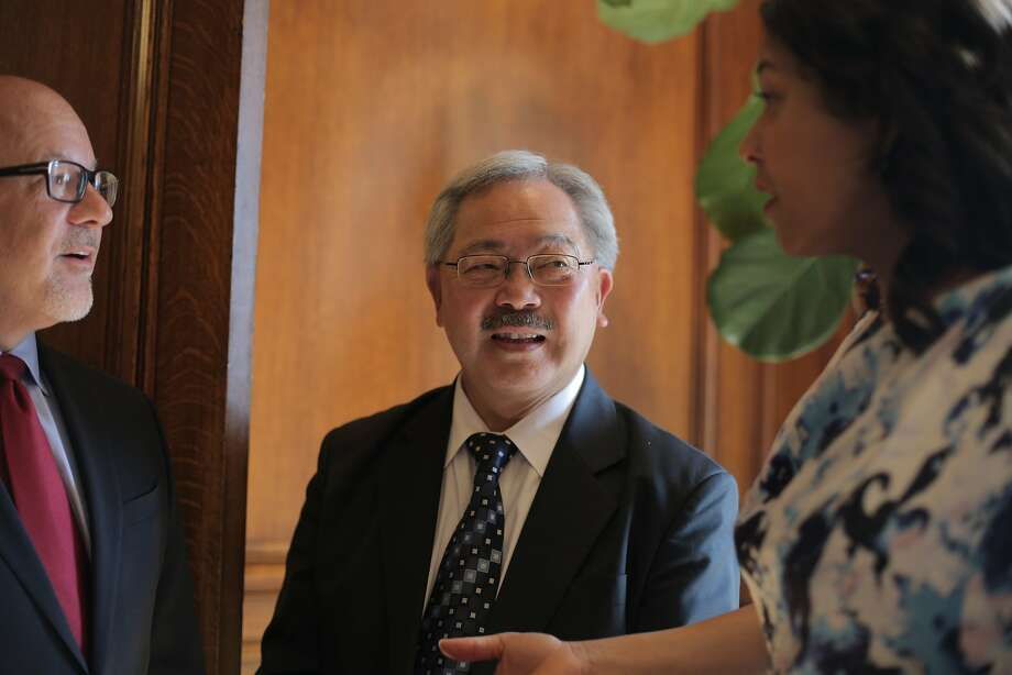 Mayor Ed Lee (center) chats with his Chief of Staff Steve Kawa (left) and San Francisco Board of Supervisors president London Breed prior to a press conference regarding the Supreme Court's ruling in favor of same-sex marriage at City Hall in San Francisco, California, on Friday, June 26, 2015. Photo: Loren Elliott, The Chronicle