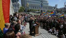 Mayor Ed Lee speaks to a large crowd during a press conference at City Hall in San Francisco, California, following the Supreme Court's ruling in favor of same-sex marriage on Friday, June 26, 2015. The Fourteenth Amendment requires a state to license a marriage between two people of the same sex.