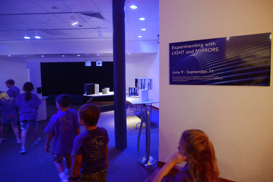 Children enter the Light and Mirrors exhibit Friday morning. Children with Circle K Kiddie Ranch explored the Experimenting with Light and Mirrors interactive science exhibition at the Texas Energy Museum on Friday morning. The exhibit showcases fundamental principals about light and reflection. Photo taken Friday 6/26/15 Jake Daniels/The Enterprise Photo: Jake Daniels / ©2015 The Beaumont Enterprise/Jake Daniels