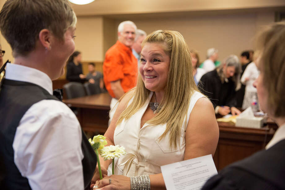 Bernice Reyes smiles at Sara Sharp during their wedding vows at the Bexar County Courthouse in San Antonio, Texas on June 26, 2015.  They have been together for three and a half years. Photo: Carolyn Van Houten, San Antonio Express-News / 2015 San Antonio Express-News