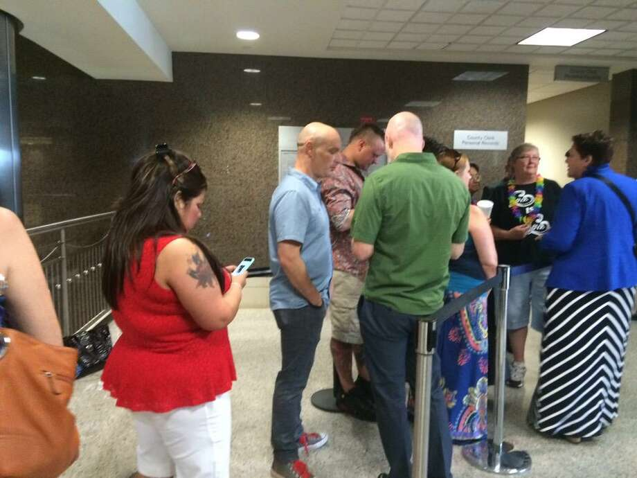 The first same-sex and transgender couples began waiting in line for the state to issue marriage licenses at the Harris County Civil Courthouse on Friday morning, June 26.The Supreme Courtdeclared gay marriage a national right that morning. Harris County Clerk Stan Stanart began issuing same-sex marriage licenses at 3 p.m. following a legal confrontation with the county attorney's office. Photo: Gabrielle Banks/Houston Chronicle
