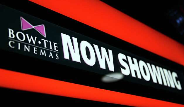 Now Showing sign inside the new Bow Tie Cinemas at Wilton Mall Thursday Oct. 24, 2013, in Saratoga Springs, NY.  (John Carl D'Annibale / Times Union) Photo: John Carl D'Annibale / 00024345A