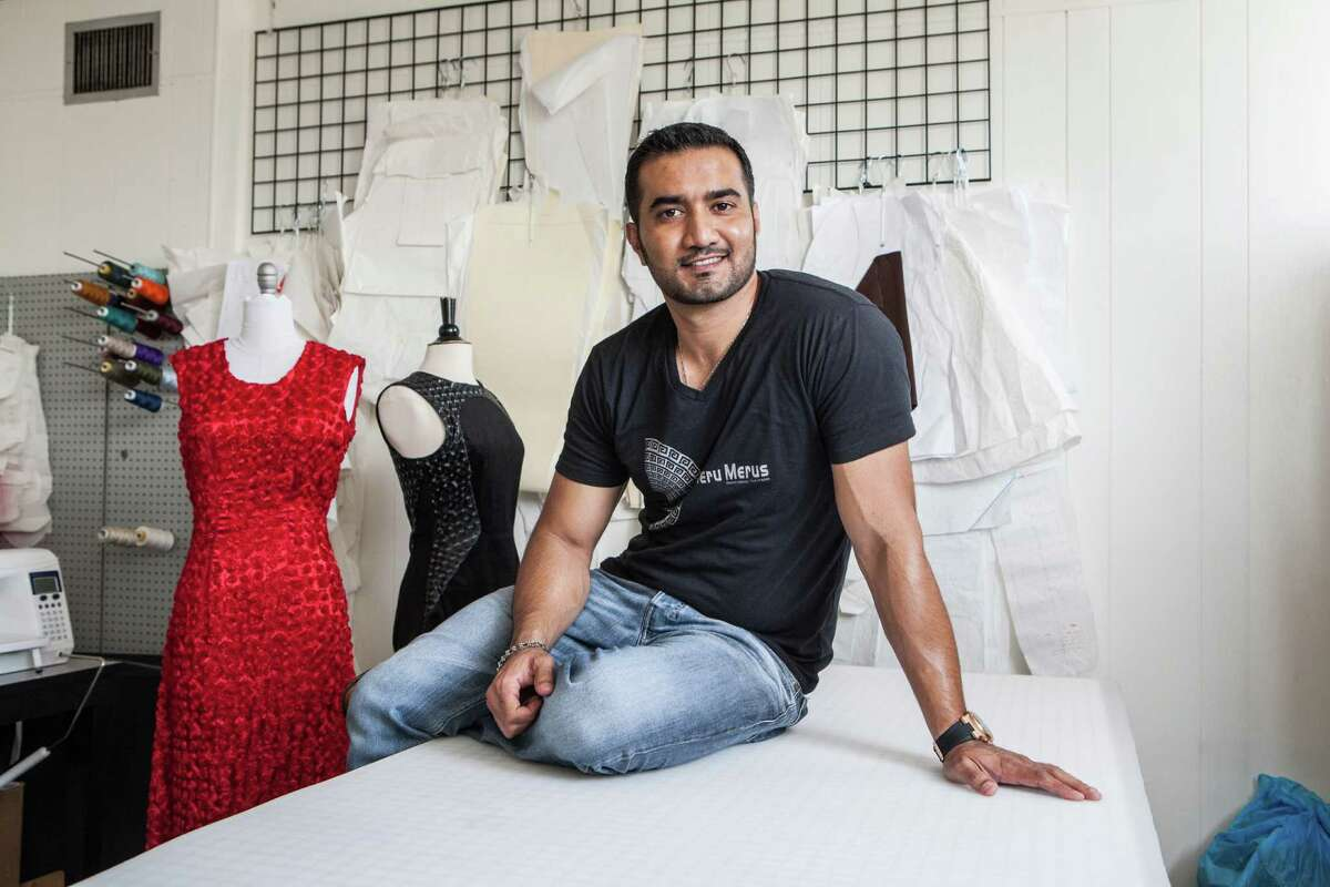 Umair Khan poses for a portrait in his studio Tuesday June 2, 2015. Khan is a fashion designer and stylist who designs dresses under the name Meru Merus. (Michael Starghill, Jr.)