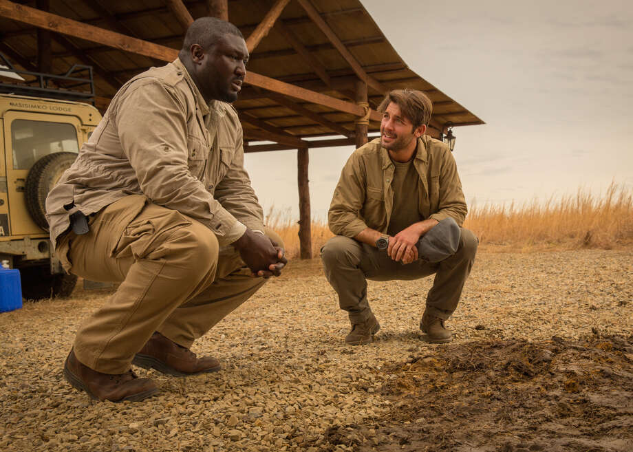 ZOO, a new drama based on the #1 bestselling novel by James Patterson, will premiere Tuesday, June 30. A renegade  zoologist (James Wolk, right) is thrust into the race to unlock the pandemic's mystery before there's no place left for people to hide. Left, Nonso Anozie as   Abraham Kenyatta Photo: Hilary Bronwyn Gayle, STR / �©2015 CBS Broadcasting, Inc. All Rights Reserved