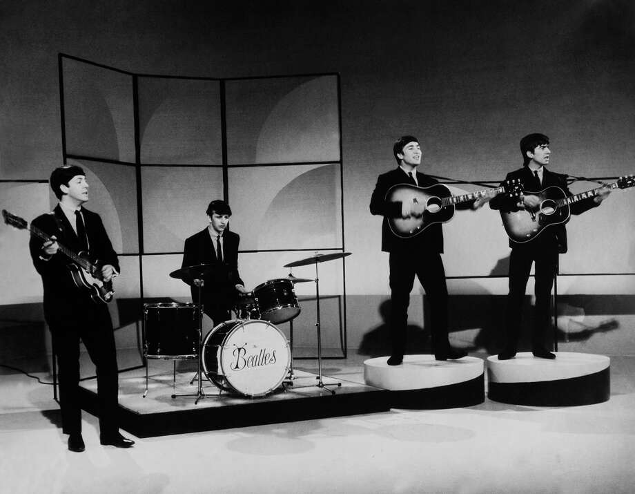 """The Beatles early in their career, shortly after Ringo Starr joined the group. Note the short-lived """"bug"""" band logo on Starr's drums. Photo: Keystone-France/Gamma Keystone"""