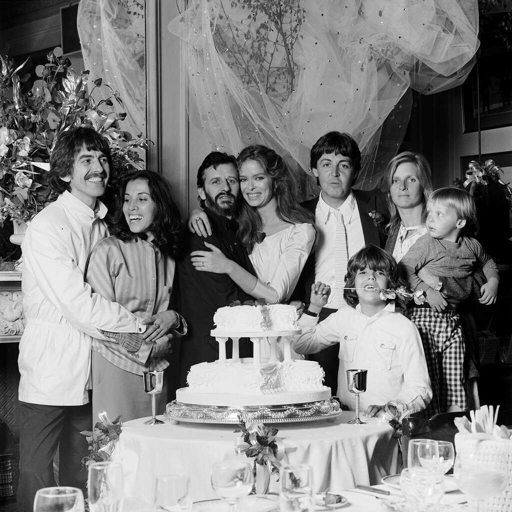 Ringo Starr and Barbara Bach's wedding day, April 27, 1981, with the two other surviving Beatles and their families. Linda McCartney is holding James, her son with Paul McCartney. The other child is Bach's by a previous marriage, Gianni Gregorini. Photo: Terry O'Neill