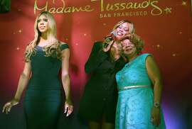 """Transgender star Laverne Cox of series """"Orange is the New Black"""" with her mother Gloria Cox (right) at Madam Tussaud's Wax Museum where her wax figure is unveiled in San Francisco, Calif., on Friday, June 26, 2015"""