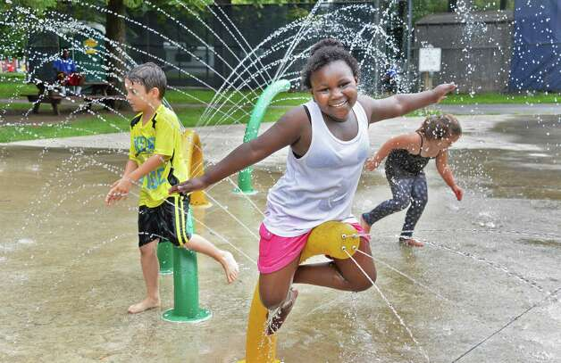 Akira Williams, 7 of Albany plays in the spray pool at Swinburne Park as the city spray pools open for the summer Friday June 26, 2015 in Albany, NY.  (John Carl D'Annibale / Times Union) Photo: John Carl D'Annibale / 00032336A