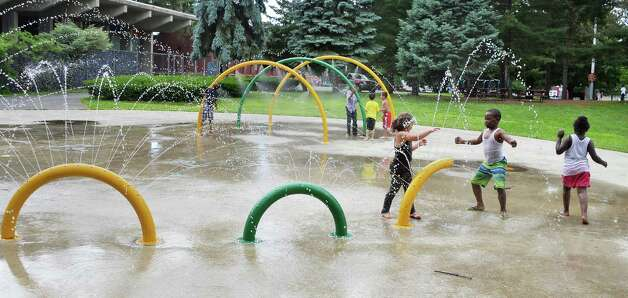 Children play in the spray pool at Swinburne Park as the city spray pools open for the summer Friday June 26, 2015 in Albany, NY.  (John Carl D'Annibale / Times Union) Photo: John Carl D'Annibale / 00032336A