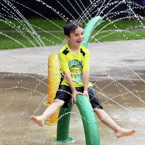 Seven-year-old Tucker Sorenson of Albany plays in the spray pool at Swinburne Park as the city spray pools open for the summer Friday June 26, 2015 in Albany, NY.  (John Carl D'Annibale / Times Union) Photo: John Carl D'Annibale / 00032336A
