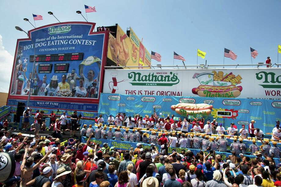 Thousands of people attend the annual Nathan's Famous Hot Dog Eating contest on July 4 in Coney Island. Photo: John Minchillo, FRE / FR170537 AP
