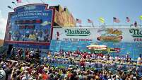 Thousands of people attend the annual Nathan's Famous Hot Dog Eating contest on July 4 in Coney Island.