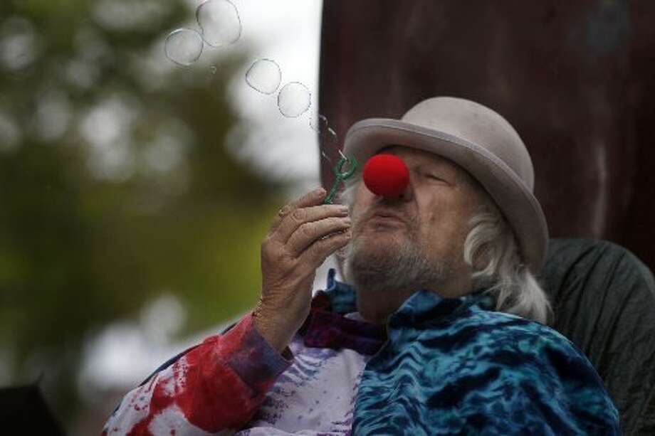 Wavy Gravy blows bubbles in 2014