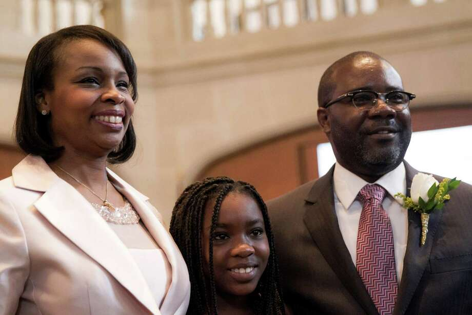 Mayor Ivy Taylor stands with her husband Rodney and daughter Morgan after being introduced at City Hall in San Antonio. Photo: Ray Whitehouse /San Antonio Express-News / 2015 San Antonio Express-News