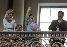 Nobel Prize laureate Malala Yousafzai waves to the crowd after being recognized on Friday, June 26, 2015, at a San Francisco City Hall celebration of the signing of the UN Charter in San Francisco 70 years prior.