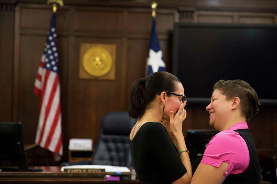 Tiana Lucas talks to Kelly Motley, who is wiping away tears, before getting married at the Bexar County Courthouse in San Antonio, Texas on June 26, 2015. Photo: Carolyn Van Houten, Staff / San Antonio Express-News / 2015 San Antonio Express-News