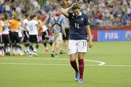 MONTREAL, QC - JUNE 27: Claire Lavogez #11 looks down after giving away the win to team Germany during the FIFA Women's World Cup Canada 2015 quarter final match between Germany and France at Olympic Stadium on June 27, 2015 in Montreal, Canada.  (Photo by Francois Laplante/FreestylePhoto/Getty Images)