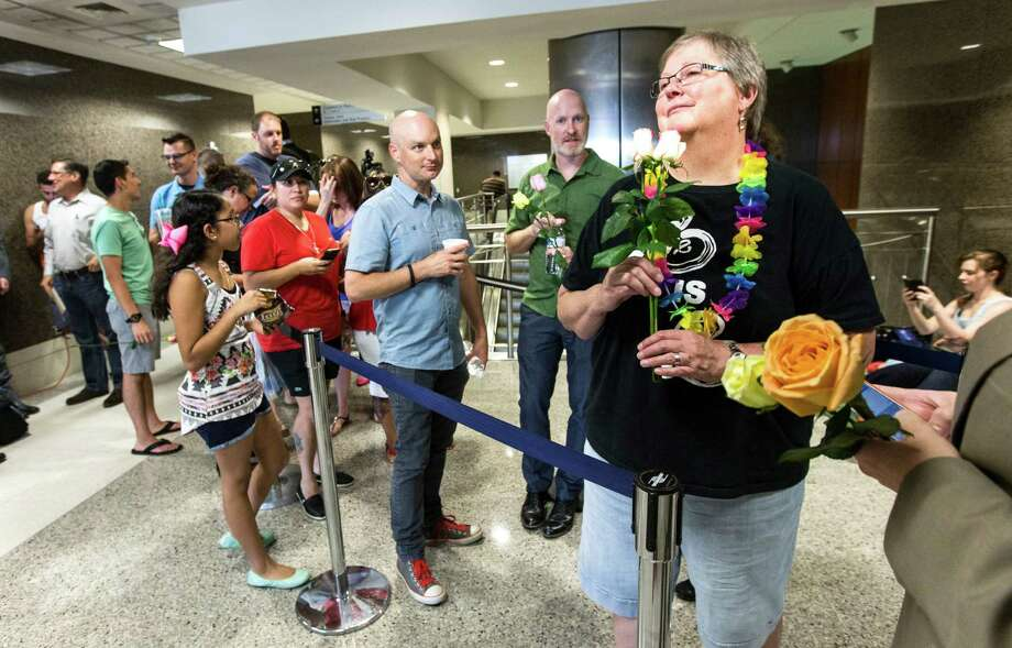 Couples wait in line to have a marriage licenses issued at the Harris County Clerk's office Friday. In a 5-4 decision, the Supreme Court legalized same-sex marriage nationwide, striking down the remaining bans in Texas and a dozen other states. Justice Anthony Kennedy wrote the decision. Photo: Brett Coomer, Staff / © 2015 Houston Chronicle