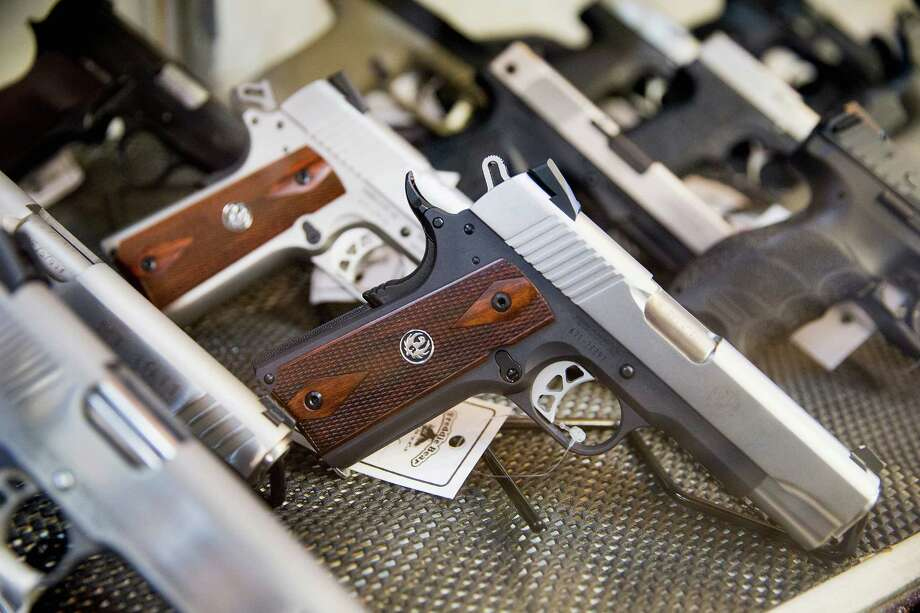 TINLEY PARK, IL - MARCH 11:  Handguns are offered for sale at Freddie Bear Sports on March 11, 2015 in Tinley Park, Illinois. According to a survey conducted by the University of Chicago 32 percent of Americans own guns, down from a high of 50 percent of the population in the 1970s and early 1980s.  (Photo by Scott Olson/Getty Images) ORG XMIT: 542237105 Photo: Scott Olson / 2015 Getty Images