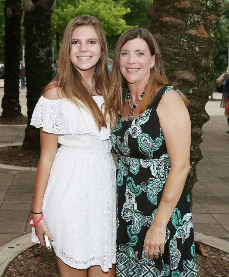 Fans pose for a photo before the Garth Brooks and Trisha Yearwood concert at the Toyota Center Friday, June 26, 2015, in Houston. Photo: Jon Shapley, Houston Chronicle / © 2015 Houston Chronicle