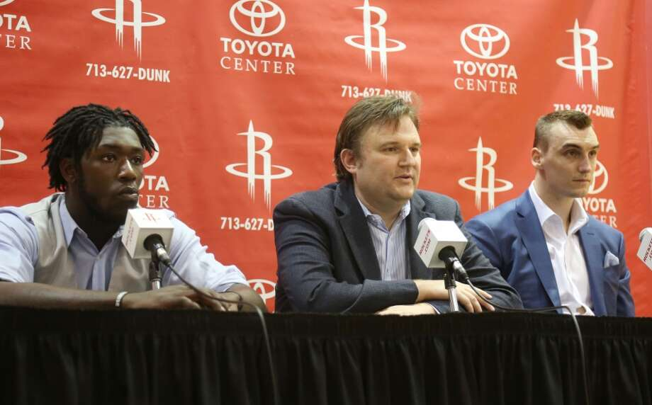 Rockets draft picks Montrezl Harrell, left, and Sam Dekker, right, flank Rockets General Manager Daryl Morey during a press conference regarding the Rockets 2015 NBA Draft picks Friday, June 26, 2015, in Houston. ( Jon Shapley / Houston Chronicle ) Photo: Houston Chronicle
