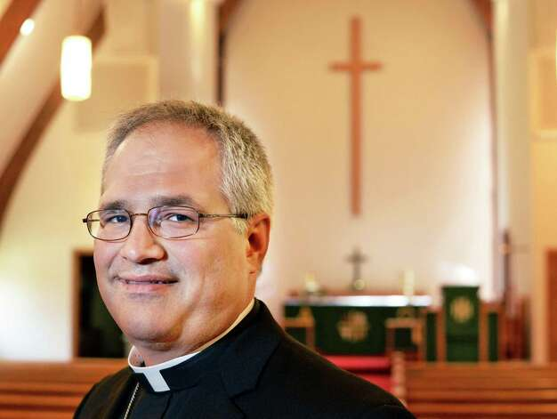 Rev. Derek Lecakes in the Sanctuary of the Immanuel Lutheran Church Friday June 26, 2015 in Niskayuna, NY.  (John Carl D'Annibale / Times Union) Photo: John Carl D'Annibale / 00032396A