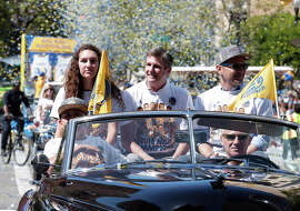 Warriors President Rick Welts (center) will be riding in his second big parade this month Sunday — he was in the Warriors' event last week.